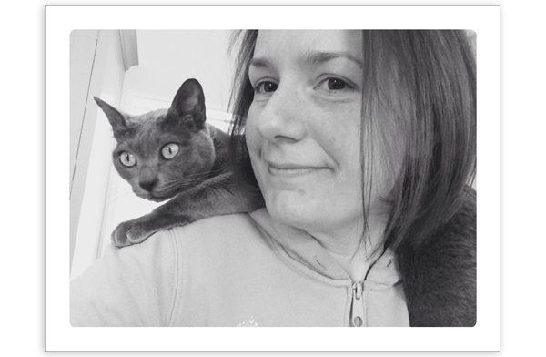 Helen with her cat Merry on her shoulder